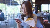 leves : Asian Business Woman Using Smart Phone At Coffee Shop Stock mozgókép