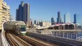 kablolar : Kaohsiung, Taiwan - January 20 2019: View Of Light Rail Tram And The Skyline Stok Video
