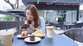 shoot vegetable : woman Holding Phone Shooting delicious cafe Food
