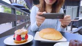 dish photo : woman Holding Phone Shooting delicious cafe Food