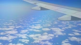 Blue Sky View From Aircraft Airplane And White Clouds Over The Ocean.