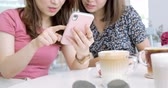 both : Woman Share Something On Cellphone To Her Friends Stock Footage