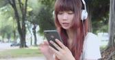 Young Asian Woman Listen To Music With Earphone And Her Smart Phone Stok Video