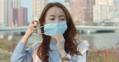contagion : Woman Feeling Sick And Wearing Face Mask Stock Footage