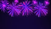 Colorful fireworks on a dark blue background. Bright fireworks in the night sky with stars. Beautiful festive sky for bright design. Animated background, seamless loop