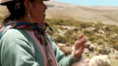 southamerica : Countrywoman spinning wool in the Andes of Peru. November 2010 ? Farmer woman spinning Alpaca-Wool in the Andes of Peru, near by Arequipa Stock Footage