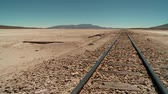 encerramento : video footage of rails in the middle of nowhere in Bolivia Salar de Chiguana