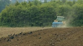 video footage of a tractor plowing acre in germany