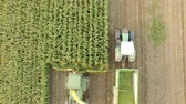 Aerial video of harvesting a corn field in germany with a combine harvester Stock Footage