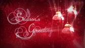 magický : Christmas Ornament Seasons Greetings features swinging Christmas ornaments on a red background with Seasons greetings text animating on screen with light beams Dostupné videozáznamy