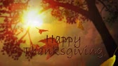 bênção : Happy Thanksgiving Leaves Through Trees features a camera looking at the sky through tree limbs and falling leaves and an animated Happy Thanksgiving message Vídeos