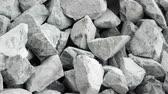 takviye edilmiş : Gravel of large fractions. Crushed stone, building aggregate, stone structure. Pile of building material