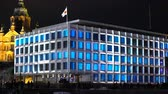 luxo : HELSINKI  FINLAND - FEB 13 2017: Festival of Light Lux Helsinki 2017. Animated Film the Cube on the Front of the Office of Stora Enso.
