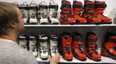 thrift : HELSINKI, FINLAND - NOVEMBER 04, 2016: Many buyers choose ski and snowboard equipment during the show DIGIEXPO 2016 in Messukeskus Expocenter.
