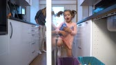 utilization : Little Girl Drops The Trash Into Kitchen Recycling Bins. Slow motion. Dolly Shot