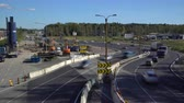 waggon : ESPOO, FINLAND - SEPTEMBER 15, 2016: Lot of cars go round the construction site of the temporary multi-lane road. Time Lapse Stock Footage