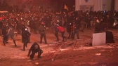 para : KIEV, UKRAINE - JANUARY 20, 2014: Protesters attack police, throw stones and set fire to tyres during clashes in Kiev on the street Grushevskogo.