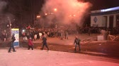 remonstrance : KIEV, UKRAINE - JANUARY 20, 2014: Protesters attack police, throw stones and set fire to tyres during clashes in Kiev on the street Grushevskogo.
