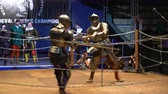 cavaleiro : MOSCOW, RUSSIA - APR 12, 2016: Two Medieval Knight Fighting In The Arena Two-Handed Swords. Great Knights tournament Valor and Honor .