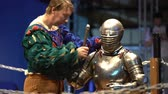 cavaleiro : MOSCOW, RUSSIA - APR 12, 2016: A Squire Helps A Knight To Wear A Helmet Before A Fight. Great Knights tournament Valor and Honor .