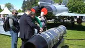 turbofan : HELSINKI, FINLAND - JUNE 09, 2017: Visitors to the exhibition visiting the new aircraft engine Rolls Royce during THE KAIVOPUISTO AIR SHOW 2017.