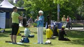 sect : HELSINKI, FINLAND - JUNE 11, 2017: Gathering of Chinese Falun Gong or Falun Dafa practitioners in the city park. Stock Footage