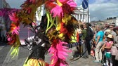 men : HELSINKI, FINLAND - JUNE 10, 2017: Women in carnival costumes dance on the streets of the city during the Helsinki Samba Carnaval 2017.