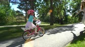 bisiklete binme : First cycling. Mother teaches her daughter to ride a bicycle.