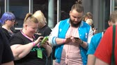 gamers : HELSINKI, FINLAND - JULY 29, 2017: A group of young people play mobile games on your phone via Wifi network. Stock Footage