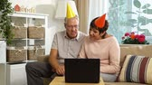 szülői : Happy Grandpa and Grandma Congratulate their Grandchildren Happy Birthday Using Laptop Video Call. Slow Motion