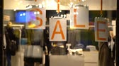 vitrin : Sale sign and showcase model. Holiday sales in the city center. Stok Video