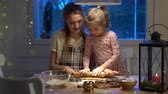christmas recipes : Young mother and her cute little daughter prepare Christmas cookies