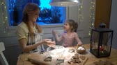 plastilina : Young mother and her cute little daughter prepare Christmas cookies and play with flour.