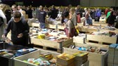 образование : HELSINKI, FINLAND - OCTOBER 29, 2017: Many lovers of reading, buyers, publishers and books at the big book fair. A huge book fair at the Expocentre Messukeskus.