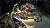 inexpensive : HELSINKI, FINLAND - FEB 03, 2018: Vintage exclusive tuning bikes. Motorcycles, mopeds, scooters, riding gear, spare parts and many people at the largest motorcycle show in the Nordic countriesries