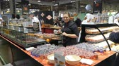 örnekleme : HELSINKI, FINLAND - MARCH 18,2018: The chefs prepare food samples and treat visitors during the Show Gastro Helsinki - big trade fair for the hotel, restaurant and catering industry