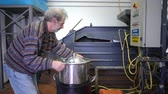 smród : Production of perfume essences using steam in a distillation cube in a small alpine village. An elderly man prepares a distillation apparatus for evaporation of perfume essences. Real people. Wideo