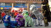 dragão : HELSINKI, FINLAND - FEBRUARY 15, 2018: Chinese New Year parade show. Traditional Chinese new year dragons on the streets of Helsinki.