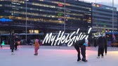 seasonal : HELSINKI, FINLAND - FEBRUARY 15, 2018: Ice skating rink in Helsinki city centre. Tourist and locals, сhildren and adults enjoying skating and Finnish winter activities