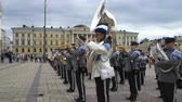 street parade : HELSINKI, FINLAND - MAY 18, 2018: The Finnish Defence Force military band performs free public concert and parade in the centre of Helsinki, Senate square Stock Footage