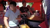 vermicelli : HELSINKI, FINLAND - MAY 26, 2018: Young people cook fast Asian food on the street.
