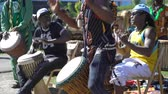 immigrants : HELSINKI, FINLAND - MAY 26, 2018: Young natives of Africa and the locals dance and play traditional folks drums in a City Park in Helsinki. Stock Footage