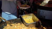 vermicelli : Street vendors prepare traditional Asian rice with vegetables on the street in Helsinki. Stock Footage