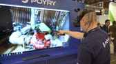 ar : HELSINKI, FINLAND - MAY 30, 2018: Engineer are using virtual AR to simulate industrial space, repair and design various technological designs. Industry 4.0 concept by finnish company Poyry during the exhibition PacTec in Helsinki