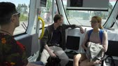 датчик : HELSINKI, FINLAND - JUNE 11, 2018: Passengers in the automated remotely operated bus in Helsinki. Unmanned public transport on streets of city.