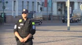 protester : HELSINKI, FINLAND - JULY 16, 2018: Meeting trump and Putin in Helsinki. Security measures. Riot police monitoring protests against the meeting between Trump and Putin