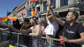 homo : OSLO, NORWAY - JUNE 30, 2018: Young people sing and dance standing on a moving platform. The Pride Parade, the highlight of Oslo Pride Week, is a huge, vibrant parade filling the city streets.