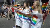 orientace : OSLO, NORWAY - JUNE 30, 2018: A lot of fancy-dress people with rainbow flags dance, sing and laugh in the street. The Pride Parade, the highlight of Oslo Pride Week, is a huge, vibrant parade filling the city streets. Dostupné videozáznamy