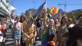 hoşgörü : OSLO, NORWAY - JUNE 30, 2018: Teams from different countries on the equality March. The Pride Parade, the highlight of Oslo Pride Week, is a huge, vibrant parade filling the city streets. Slow motion Stok Video