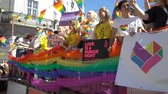 homo : OSLO, NORWAY - JUNE 30, 2018: The Pride Parade, the highlight of Oslo Pride Week, is a huge, vibrant parade filling the city streets. Slow motion